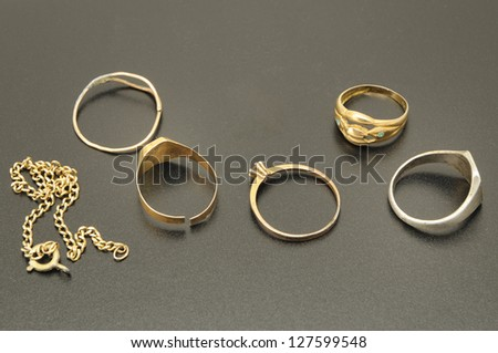 set of gold jewelry worn in black background