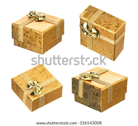 Set of golden gift box with ribbon and bow on white background - stock photo