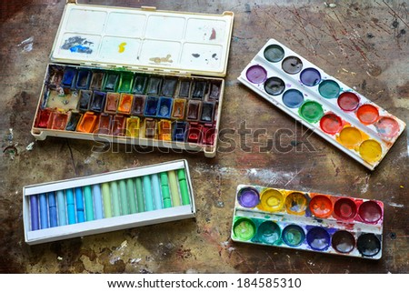 Set of gouache and watercolor paints on your desktop - stock photo