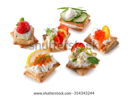 set of gourmet crackers snacks close-up isolated on white background  - stock photo
