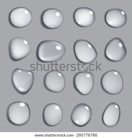 Set of gray drops of various shapes on gray background