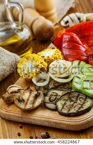 Set of grilled vegetables meal: tomato, corn, eggplant, mushroom, bell pepper, marrow and onion. Healthy organic food on a table.