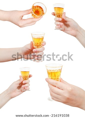 set of hand holds little glass of dessert wine isolated on white background - stock photo