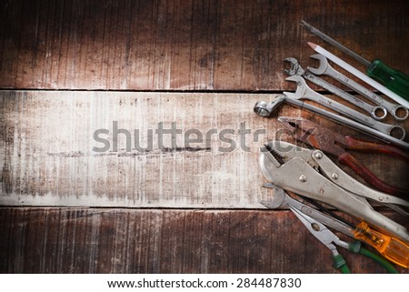 set of hand tools on a wooden panel - stock photo