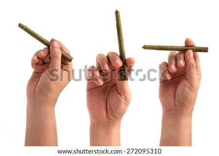 set of Hands are holding a cigarette