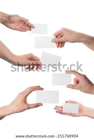 Set of hands holding empty business cards isolated on white