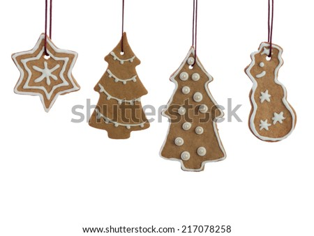 Set of Hanging Ginger Bread Christmas Cookies with white Decoration, Isolated on white - stock photo