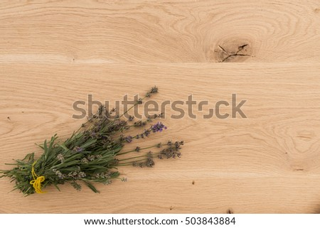 set of herbs on a wooden background