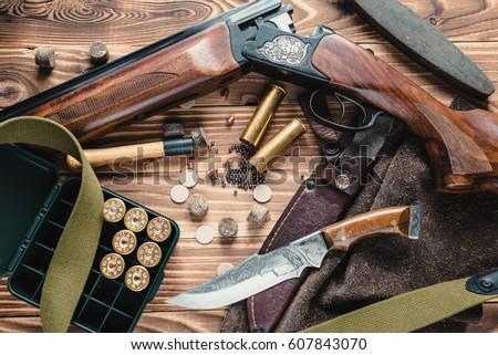 Set Of Hunting Equipment On Desk