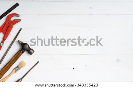 set of instruments with text space on white wooden background