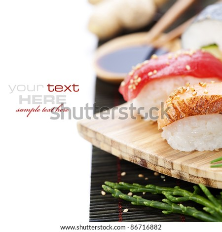 set of japanese sushi with chopsticks and soy sause over white with sample text - stock photo