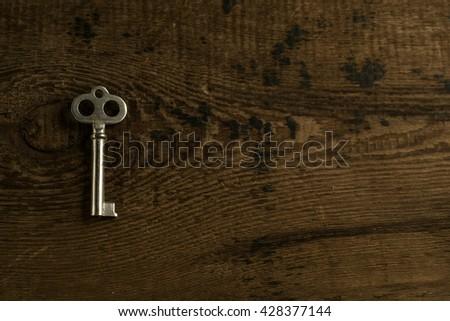 Set of keys on wood background photo - stock photo