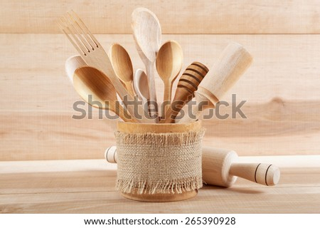 Set of kitchen utensils on wooden board. - stock photo