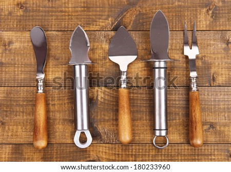 Set of knives on wooden table close-up - stock photo