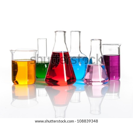 Set of laboratory flasks with a colored reagents, isolated - stock photo