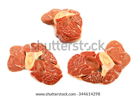 Set of large piece of red meat with a bone on a white background. - stock photo