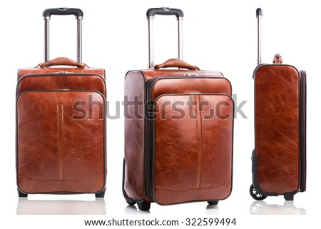 Set of leather business suitcases isolated on white background - stock photo