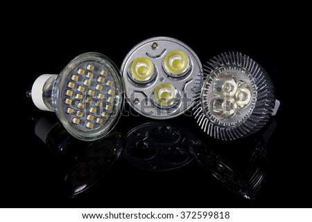 Set of 3 LED lamps isolated on black - stock photo
