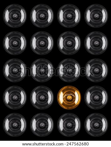 set of Light bulb illuminated isolated against black background - stock photo
