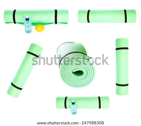 Set of Lightweight foam Yoga Mat roll isolated on white background. Sport equipment  - stock photo