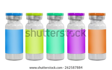 Set of lilac, blue, green and orange macro medicine injection vials isolated on white - stock photo
