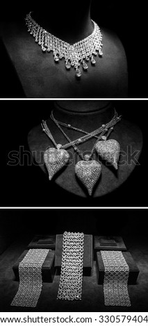 Set of luxury jewelry made of white gold or silver and diamonds. Luxury women accessories on stands - stock photo