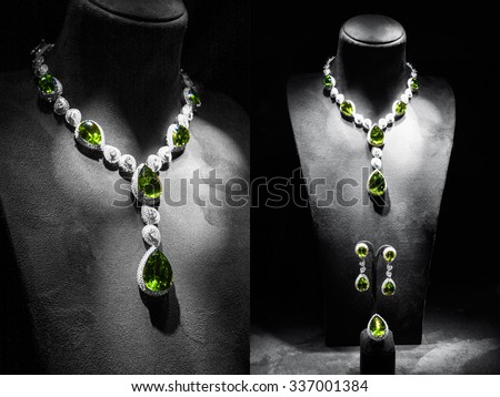 Set of luxury jewelry made of white gold with diamonds and emeralds on a stand - stock photo