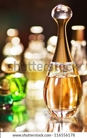 set of luxury perfume bottles on the table - stock photo