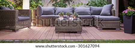 Set of luxury  wicker furniture in garden patio - stock photo