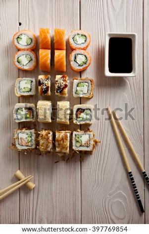 Set of Maki Sushi on Wooden Background - stock photo
