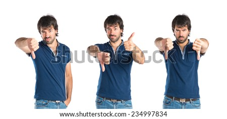 Set of Man doing a bad signal over white background - stock photo