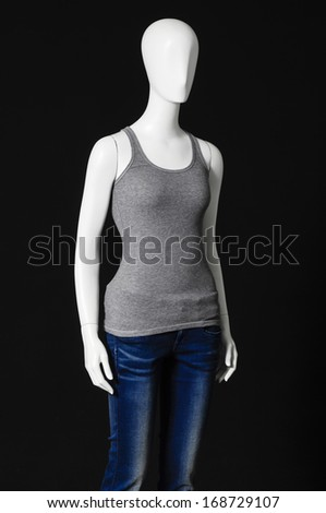 Set of mannequin dressed in gray shirt and trousers on black background