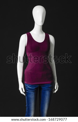 Set of  mannequin dressed in red shirt and trousers on black background