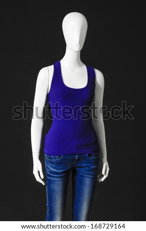 Set of mannequin dressed in two colorful shirt and trousers on black background