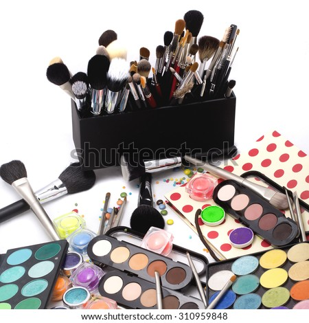 Set of many professional visagiste eyeshadow palette red orange green violet pink yellow purple black beige brown colors foundation powder and make-up brushes on white background, square picture - stock photo