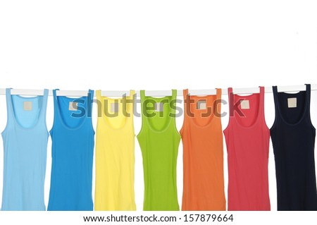 Set of many rainbow peignoir hanging on wooden hangers - stock photo
