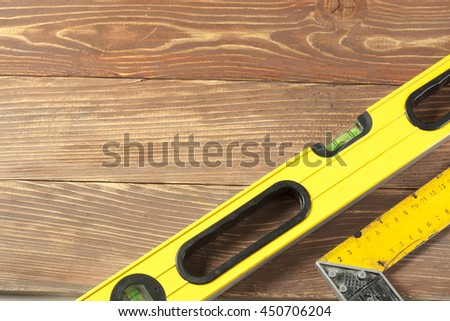 Set of measuring tools wooden table. meter measuring line construction level and square ruler maintenance concept - stock photo
