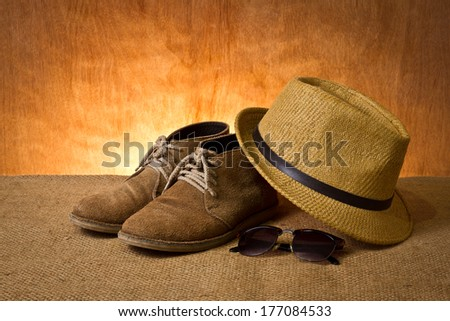 set of men's accessory, boots, panama hat and sunglasses