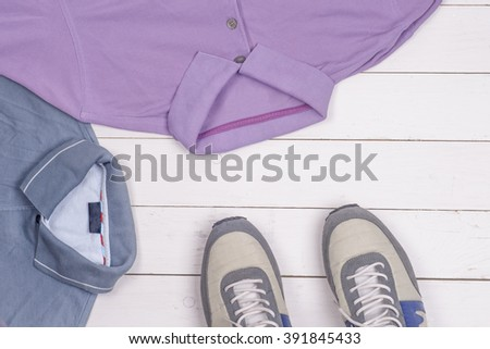 set of men's clothing and shoes on wooden background