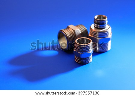 Set of metal clutches on blue background with shadow - stock photo