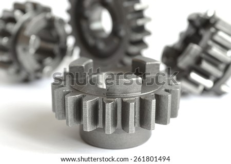 Set of metal gears on the white background. - stock photo