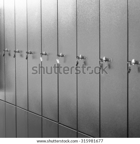 Set of metal lockers with keys, close up view