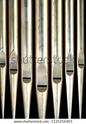 set of metal organ pipes