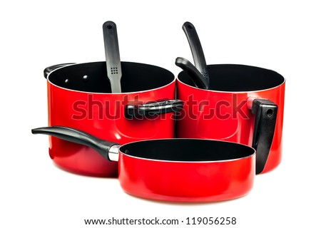 Set of metallic red cooking pots and pans isolated on white - stock photo