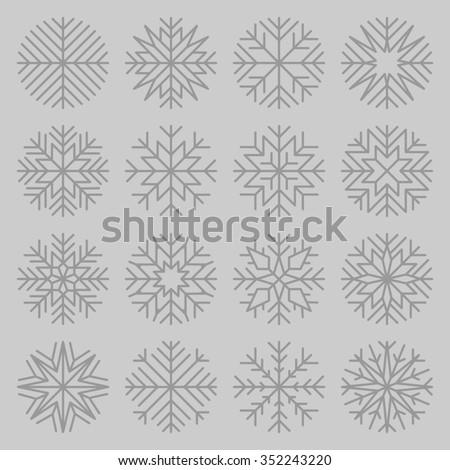 set of minimalist snowflakes on grey background - stock photo