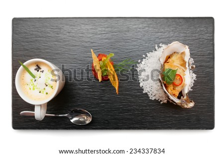Set of modern style snacks on slate plate isolated on white - stock photo