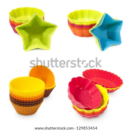 set of moulds for baking muffins isolated on white - stock photo