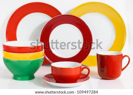 Set of  Multi Colored Dishware on white Background with soft shadow - stock photo