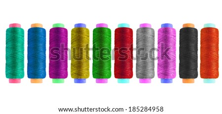 Set of multicolor silk bobbins isolated over white