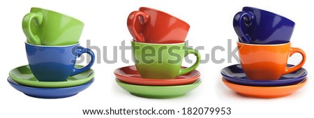 Set of multicolored cups and saucers, isolated on white background